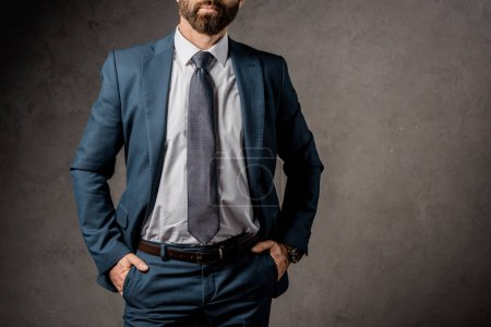 Photo for Cropped view of businessman in formalwear with hands in pockets - Royalty Free Image