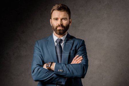 Photo for Handsome bearded businessman standing with crossed arms - Royalty Free Image