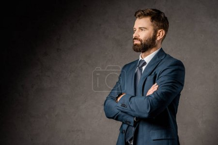Photo for Successful bearded businessman standing with crossed arms - Royalty Free Image