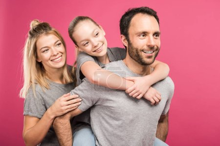 Photo for Beautiful happy family hugging together, isolated on pink - Royalty Free Image