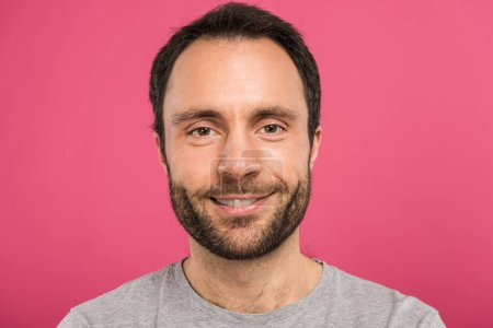 Photo for Portrait of handsome smiling man looking at camera, isolated on pink - Royalty Free Image