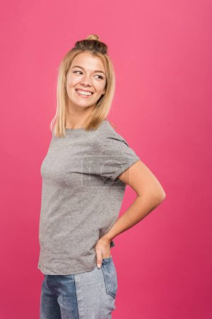 happy woman in casual clothing, isolated on pink