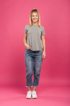 beautiful smiling woman in casual clothing, isolated on pink