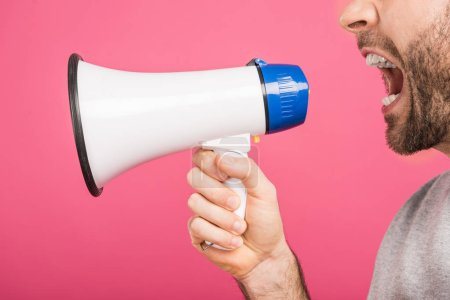 cropped view of angry man screaming with megaphone, isolated on pink