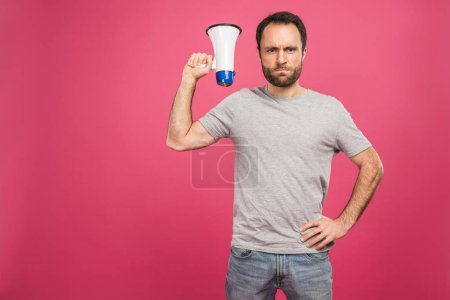 angry man holding megaphone, isolated on pink