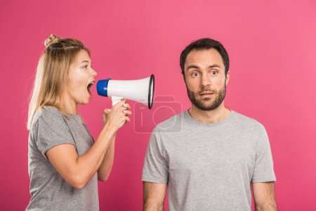 Photo for Angry woman yelling with megaphone at man, isolated on pink - Royalty Free Image