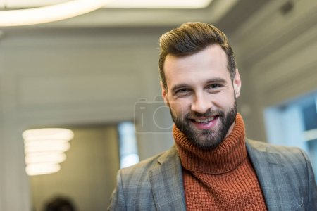 Photo for Portrait of smiling man in formal wear looking at camera - Royalty Free Image
