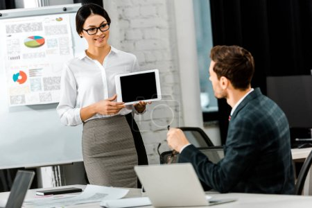 businessman and businesswoman working on new business project together at workplace in office