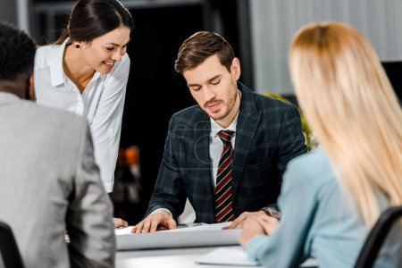 multiethnic businesspeople having discussion during meeting in office