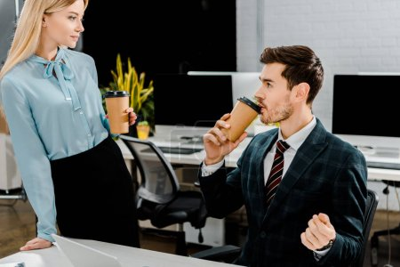 portrait of business colleagues with coffee to go in office