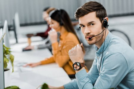 Photo for Selective focus of call center operator in headset in office - Royalty Free Image