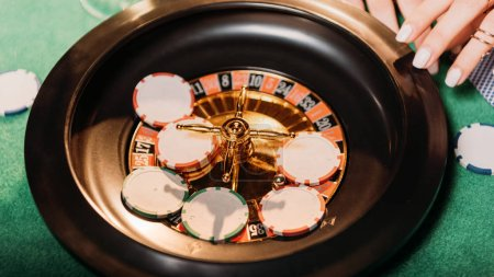 cropped image of girl playing roulette in casino