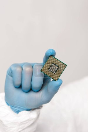 Photo for Cropped view of microchip in hand of scientist isolated on grey - Royalty Free Image