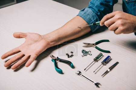Photo for Cropped view of man repairing hand with metallic tools - Royalty Free Image