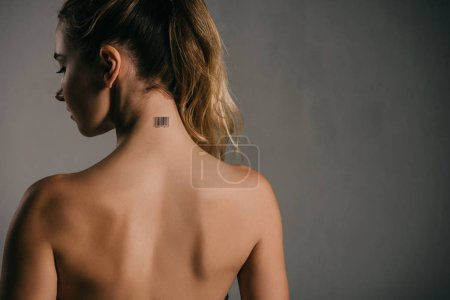back view of woman with coded neck on grey background