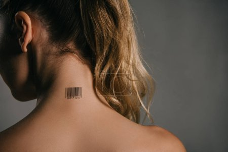 back view of woman with barcode on neck on grey background