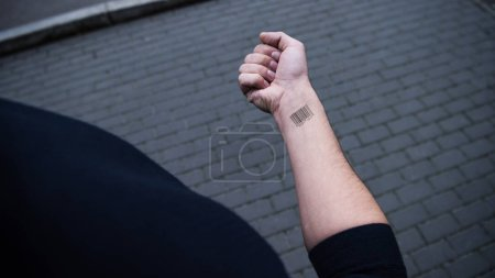 cropped view of barcode on male hand on street