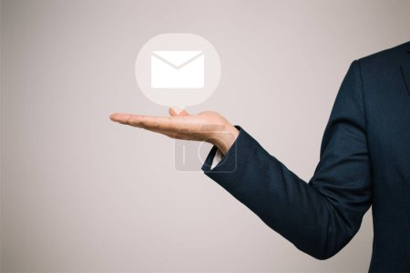 Photo for Partial view of businessman in suit gesturing and presenting email icon isolated on grey - Royalty Free Image