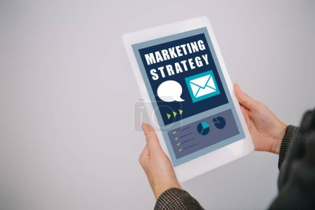Photo for Cropped view on businesswoman using digital tablet with marketing strategy isolated on grey - Royalty Free Image