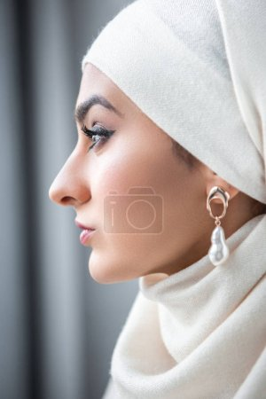 close-up portrait of beautiful young muslim woman looking away