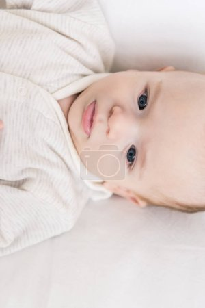 Photo for Overhead view of cute little baby boy - Royalty Free Image