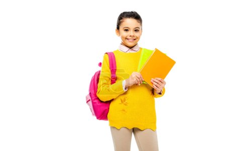 Photo pour Adorable enfant tenant des livres et regardant caméra isolé sur blanc - image libre de droit