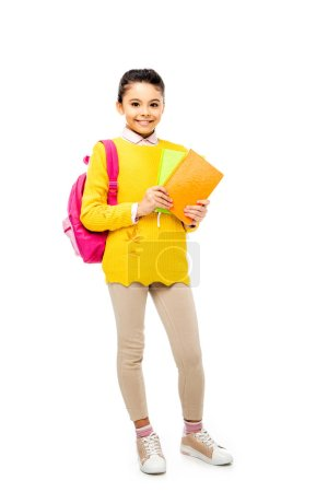 Photo for Adorable kid with backpack looking at camera isolated on white - Royalty Free Image