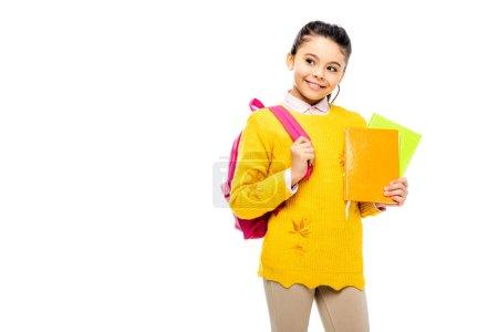 Photo pour Adorable enfant avec sac à dos tenant des livres et souriant isolé sur blanc - image libre de droit