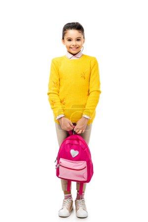 Photo pour Adorable enfant tenant le sac à dos et souriant à la caméra isolé sur blanc - image libre de droit