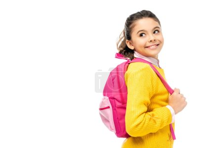 Photo for Adorable child smiling and holding pink backpack straps isolated on white - Royalty Free Image