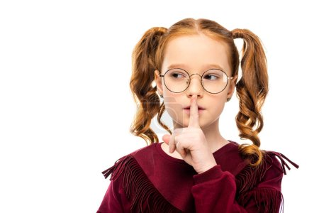 adorable kid in glasses showing silent gesture isolated on white