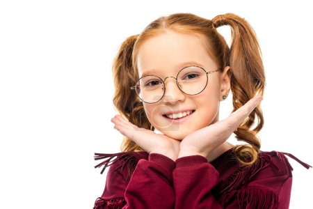 Photo for Adorable child in glasses smiling and looking at camera isolated on white - Royalty Free Image