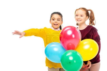 Photo for Cheerful schoolgirls holding colorful balloons isolated on white - Royalty Free Image