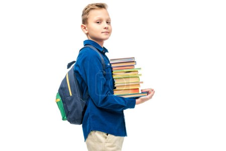 Photo for Cute boy holding stack of books and looking at camera isolated on white - Royalty Free Image