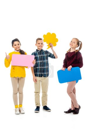 Photo for Cheerful kids holding multicolored speech bubbles, showing thumb up and looking at camera isolated on white - Royalty Free Image