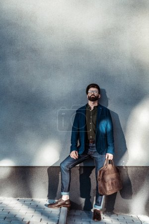 Photo for Handsome bearded man in glasses holding bag - Royalty Free Image