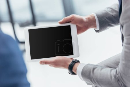 Photo for Partial view of businessman holding digital tablet with blank screen - Royalty Free Image