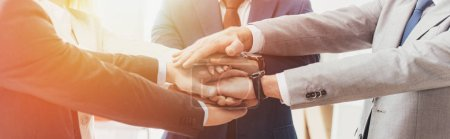 Photo for Cropped shot of professional successful business people stacking hands together - Royalty Free Image