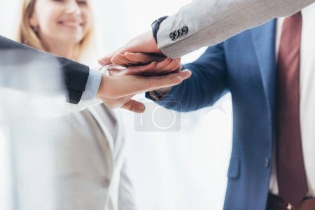Photo for Cropped shot of professional business people stacking hands together - Royalty Free Image