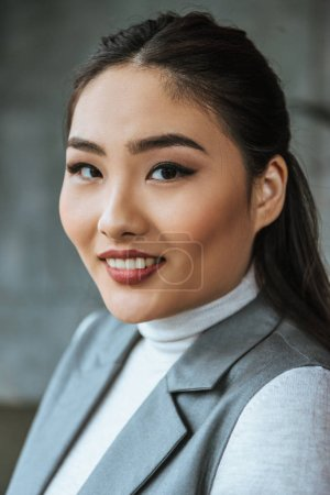 Photo for Portrait of beautiful young kazakh woman smiling at camera - Royalty Free Image