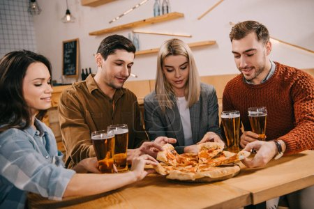 friends taking pieces of tasty pizza in bar