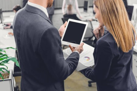 Photo for Cropped shot of focused young business colleagues using digital tablet with blank screen in office - Royalty Free Image