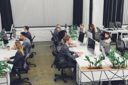 high angle view of professional young businesspeople working with desktop computers in open space office