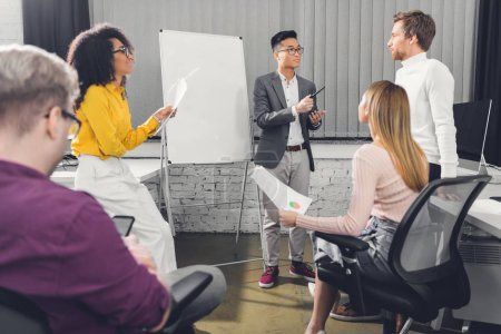 professional young multiethnic businesspeople discussing during meeting in office