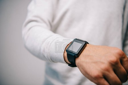 cropped view of man with smartwatch on hand isolated on grey