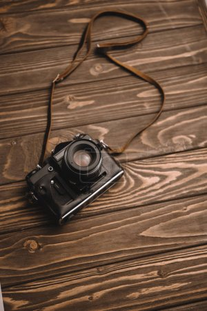 retro photo camera on wooden table with copy space