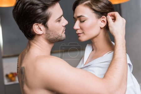 adult man gently touching girl hair with closed eyes
