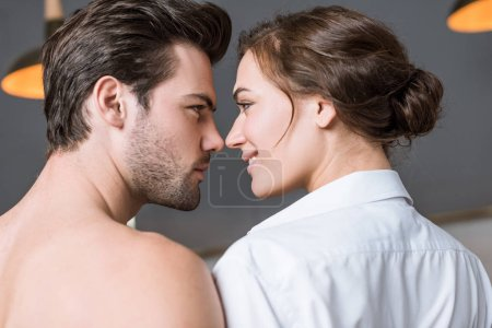adult couple smiling and looking into eyes