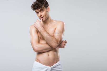 Photo for Handsome shirtless sensual man in towel isolated on grey - Royalty Free Image