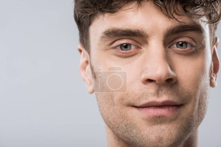 Photo for Portrait of handsome young smiling man isolated on grey - Royalty Free Image
